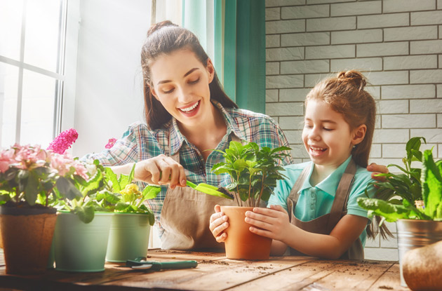 mother and daughter caring for houseplants