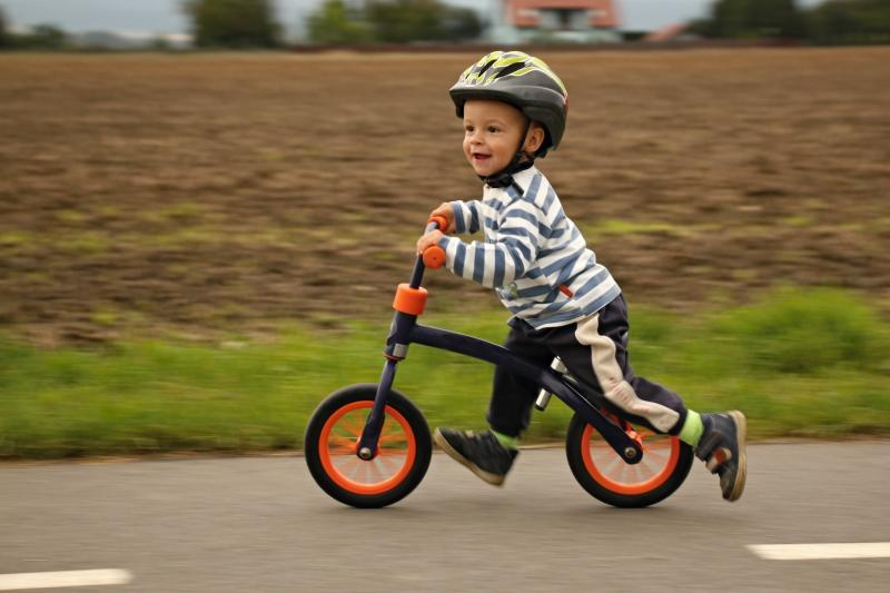 child on a balance bike