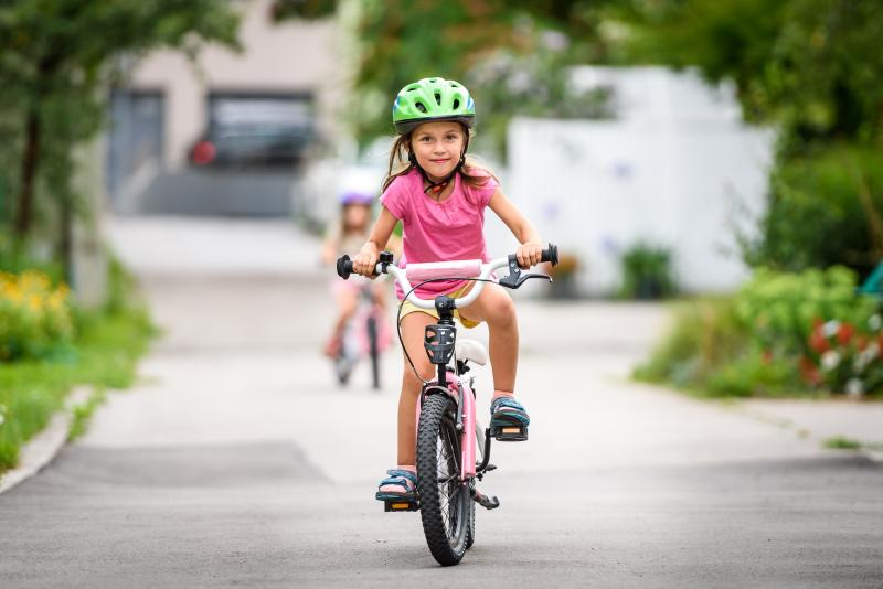 child riding a bike with pedals